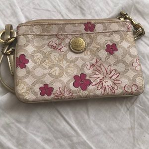 Other - 🌸COACH🌸 pink and gold  flower Wristlets